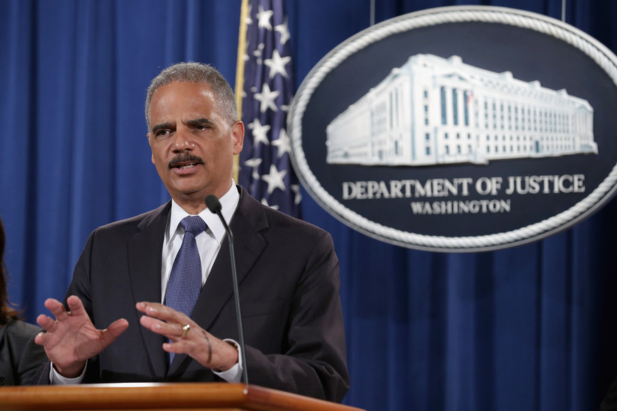 The first public indication that the Justice Department's resolve against the merger was weakening came when Attorney General Eric Holder publicly said he hoped the case would settle. (Chip Somodevilla/Getty Images)