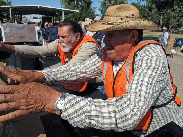 volunteers distribute emergency drought aid